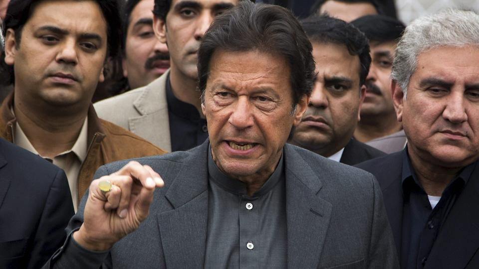 File photo of Pakistani cricketer-turned-politician Imran Khan talking to reporters outside the Supreme Court in Islamabad on February 15, 2017.