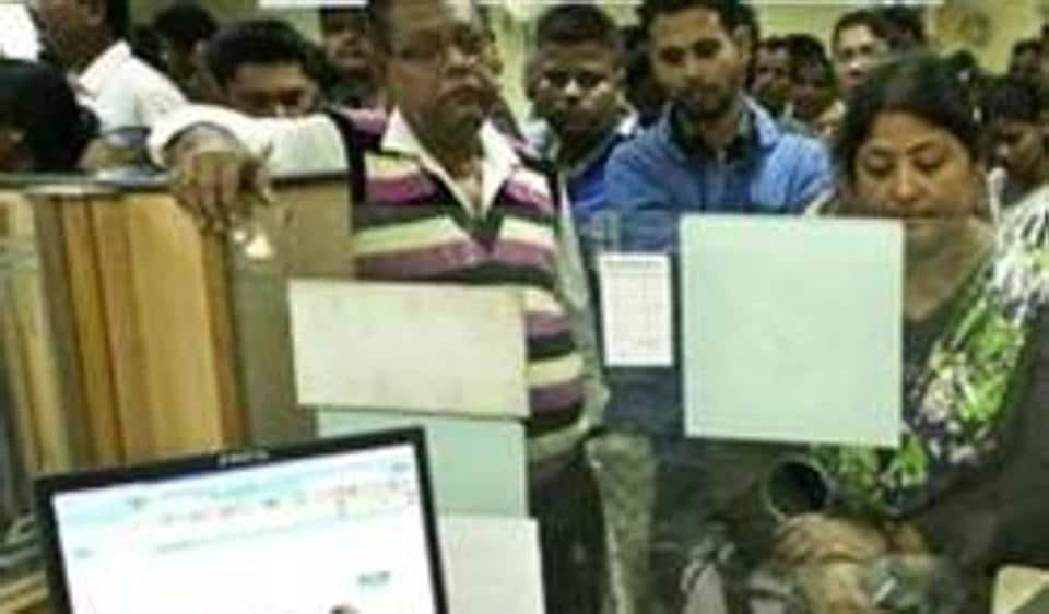 Indians deposit discontinued notes in a bank in Guwahati, India, after the government demonetised high-value currency notes in a surprise move on November 8.