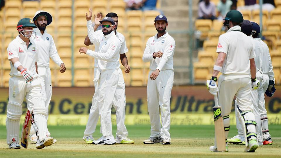 Indian cricket team players celebrate after Ravichandran Ashwin took the wicket of David Warner. (PTI)