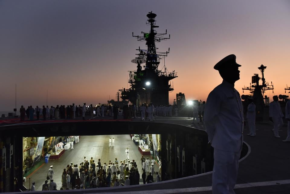 An officer aboard the longest serving aircraft carrier at Naval Dockyard on Monday.