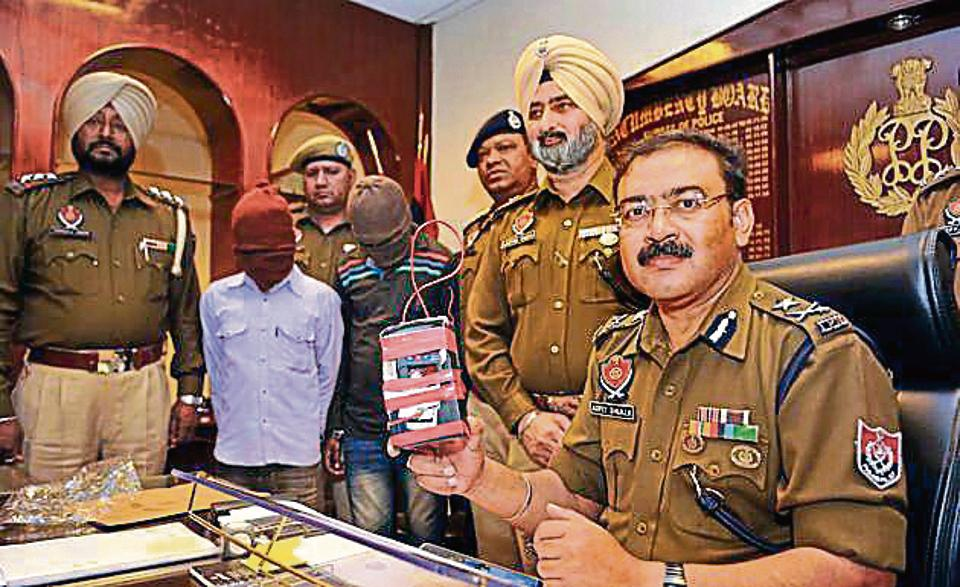 Police commissioner Arpit Shukla with the fake bomb and the accused in Jalandhar on Tuesday.