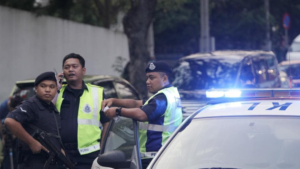 Police officers position themselves outside the North Korean Embassy in Kuala Lumpur, Malaysia.