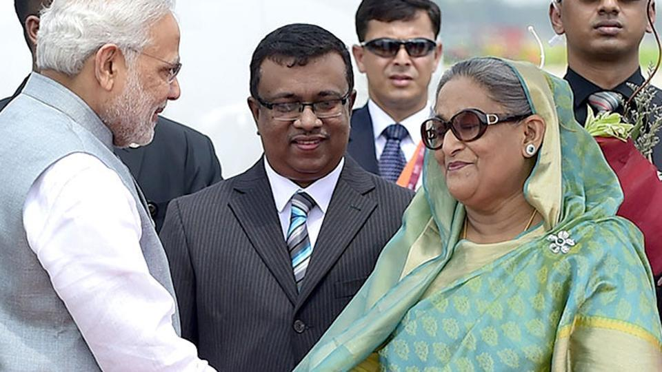 File photo of Indian Prime Minister Narendra Modi being received by his Bangladeshi counterpart, Sheikh Hasina Wajid, at the Hazrat Shahjalal International Airport in Dhaka.
