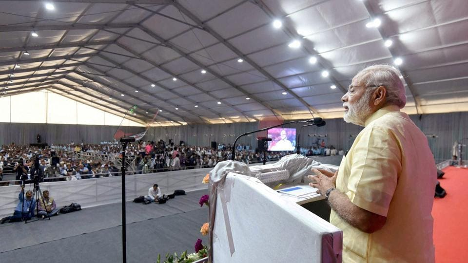 Prime Minister Narendra Modi delivering his address at the Industry Meet at ONGC Petro Additions Limited (OPAL), in Dahej, Gujarat on Tuesday.