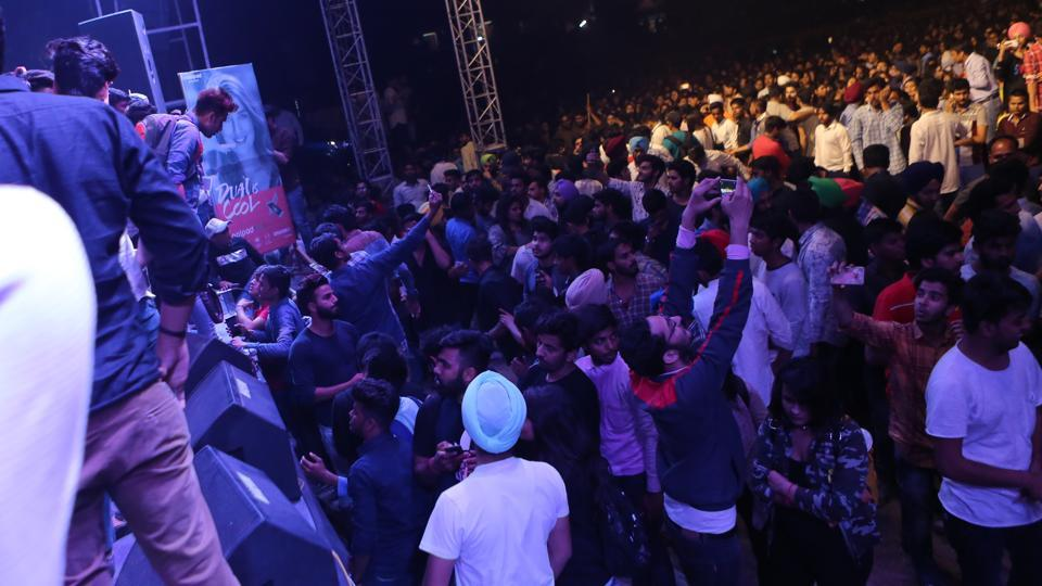 Crazy fans take selfies in front of the stage even after the commotion. (Manoj Verma/HT Photo)