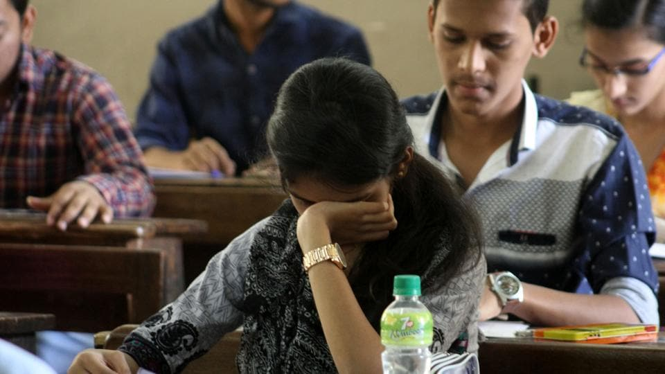 The detention of the two students indicates examinees were able to access the leaked paper on their phones that they had sneaked in.