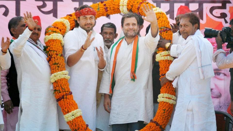 Congress vice-president Rahul Gandhi garlanded by party members at an election rally in Mirzapur on Sunday.