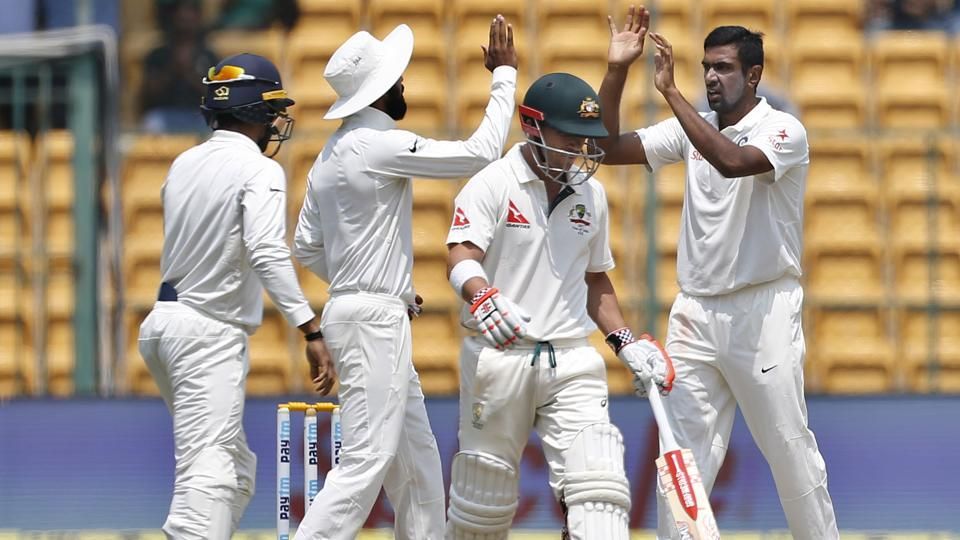 India's Ravichandran Ashwin, right, celebrates with teammates the dismissal of Australia's David Warner. (AP)