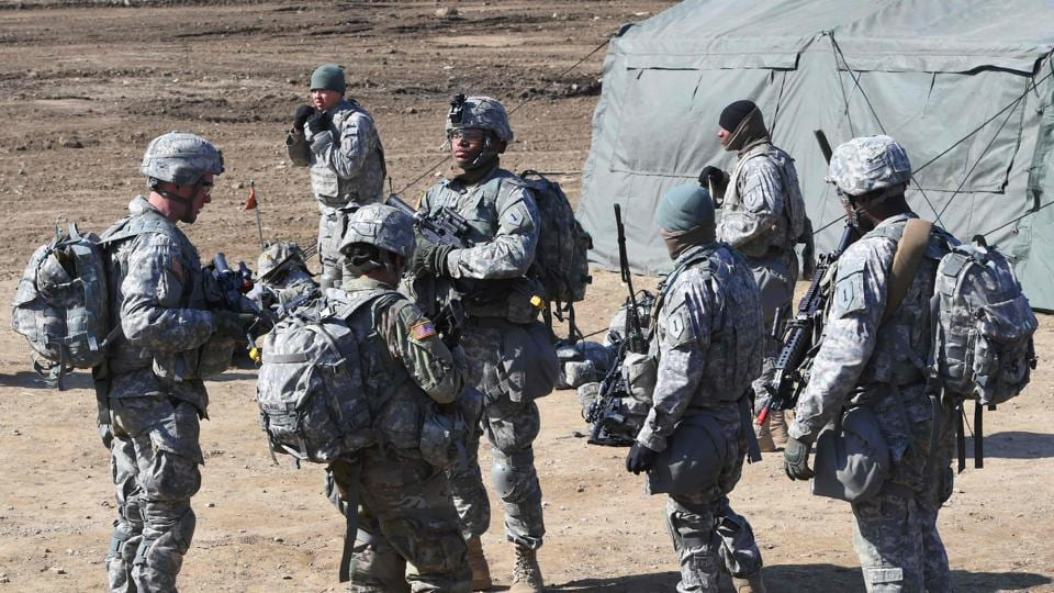 US soldiers gather during their drill at a military training field in the border city of Paju on March 7, 2017. The US military has begun deploying the THAAD anti-ballistic missile defense system to South Korea, US Pacific Command said, to protect against threats from North Korea.