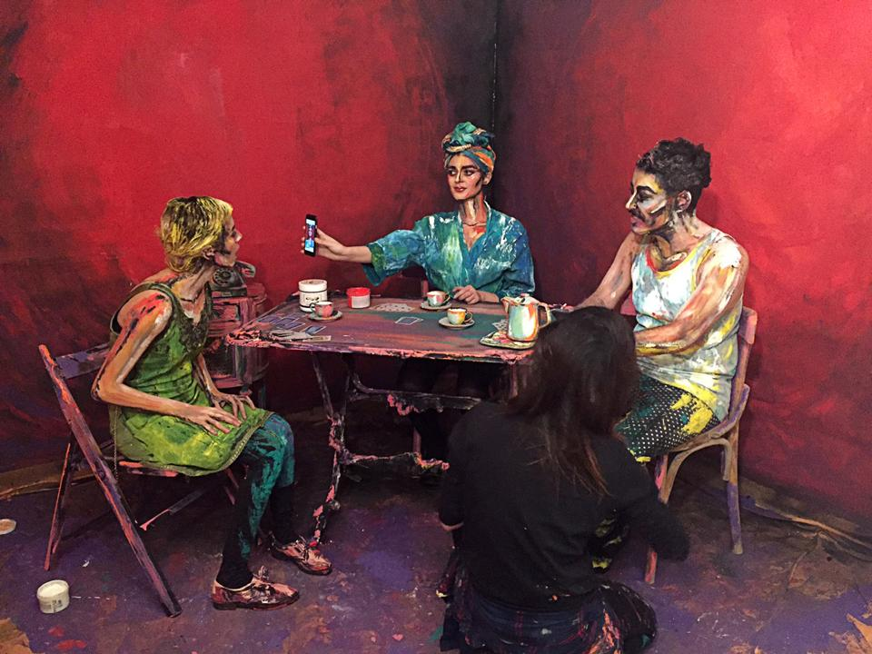 Cairo-based artist Chanel Arif's paints for her art project called After Dinner that uses humans and their surroundings as her canvas, in her gallery in the capital of Cairo. (Sherif Fahmy / REUTERS)