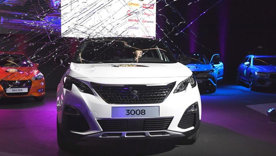 'Car of the year 2017' Peugeot 3008 on display at the 87th Geneva International Motor Show in Geneva on Monday.