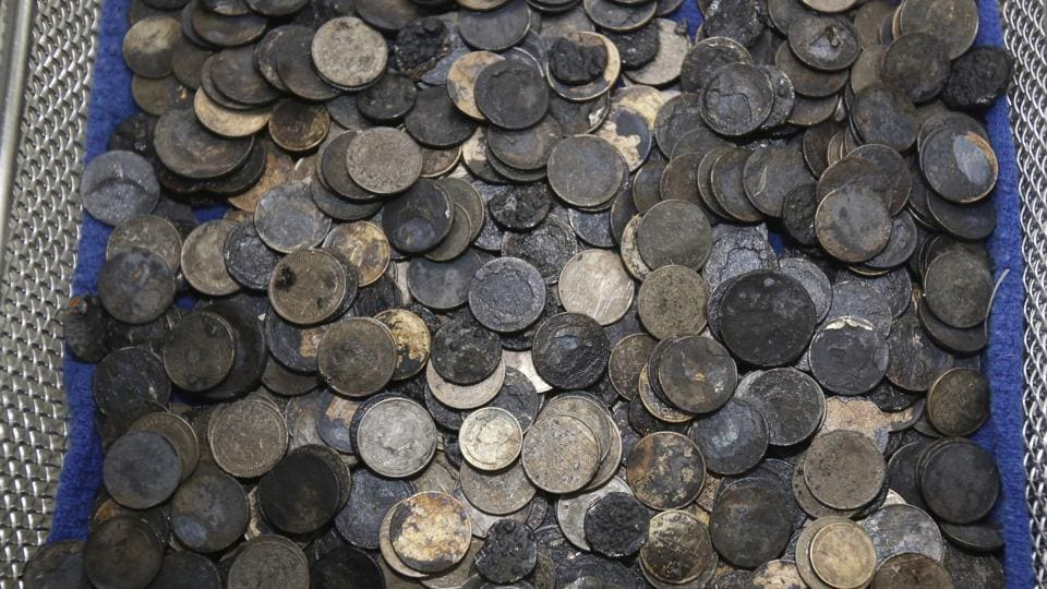 Coins that were removed from a female green turtle nicknamed 'Bank.' (Sakchai Lalit / AP)