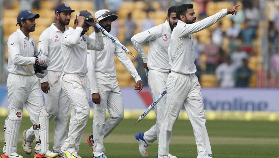 Virat Kohli leads his Indian teammates off the field after their win over Australia in the second Test.