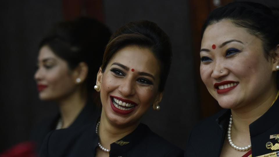Air India cabin crew of a Boeing 777-200LR share a light moment during a ceremony to celebrate the eve of International Women's Day in New Delhi. Air India says it has set a world record by circumnavigating the globe with an all woman flight and cabin crew. Press Trust of India reported that the flight flew over the Pacific Ocean from New Delhi to San Francisco last Monday, and then flew back to New Delhi over the Atlantic on Friday. (Vipin Kumar/HT PHOTO)