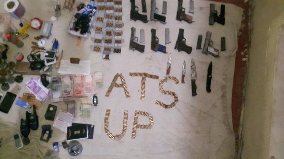 Ammunition, including eight automatic pistols, live cartridges and some explosives, and an IS flag were recovered from the site of the encounter near Lucknow.