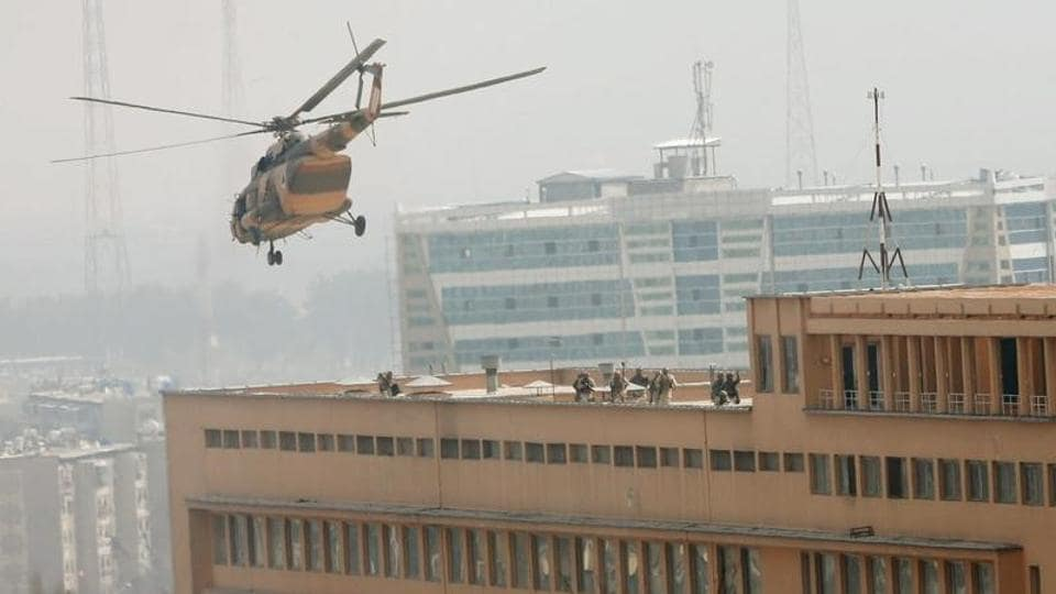Afghan National Army soldiers descend from a helicopter on the roof of a military hospital in Kabul that was attacked by Islamic State fighters on March 8, 2017.