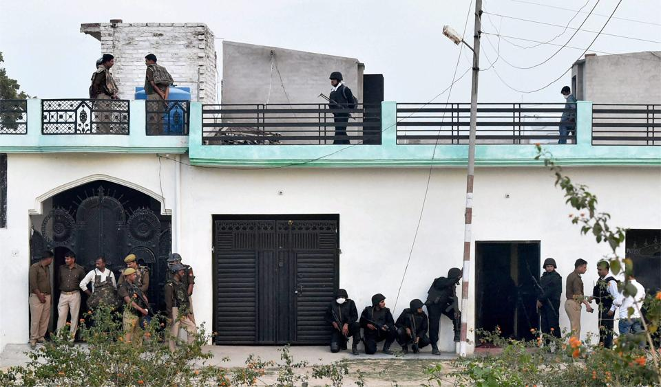 The Uttar Pradesh Anti-Terror Squad personnel take positions during an operation against a suspected terrorist in Lucknow.  The law and order situation in the state has deteriorated during the last 10 years, thanks to the patronage extended to criminals by the political class.