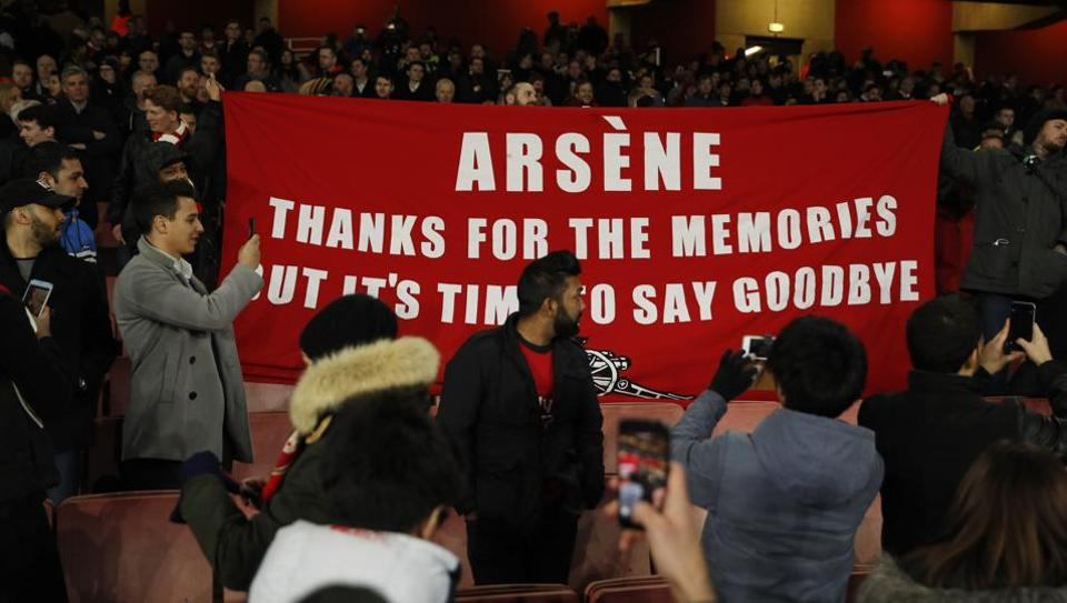 Arsenal fans hold up a banner protesting against Arsenal manager Arsene Wenger after losing 1-5 to Bayern Munich in the Champions League last-16 second leg at home on Tuesday.