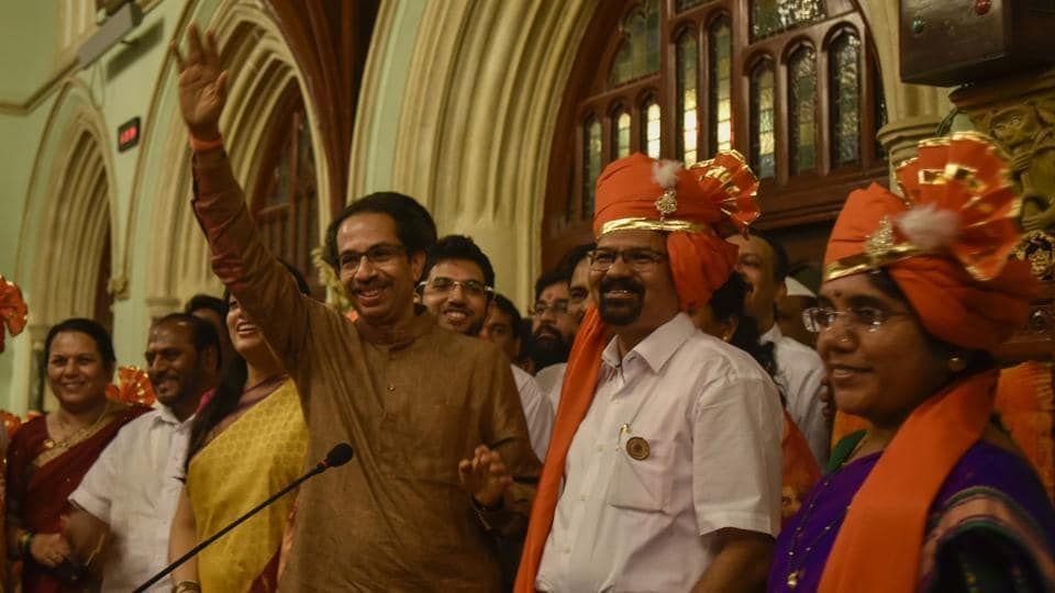 Sena president Uddhav Thackeray, with mayor Vishwanath Mahadeshwar and deputy mayor Hemangi Worlikar, addresses party workers at the BMC headquarters on Wednesday. (Kunal Patil/HT Photo)