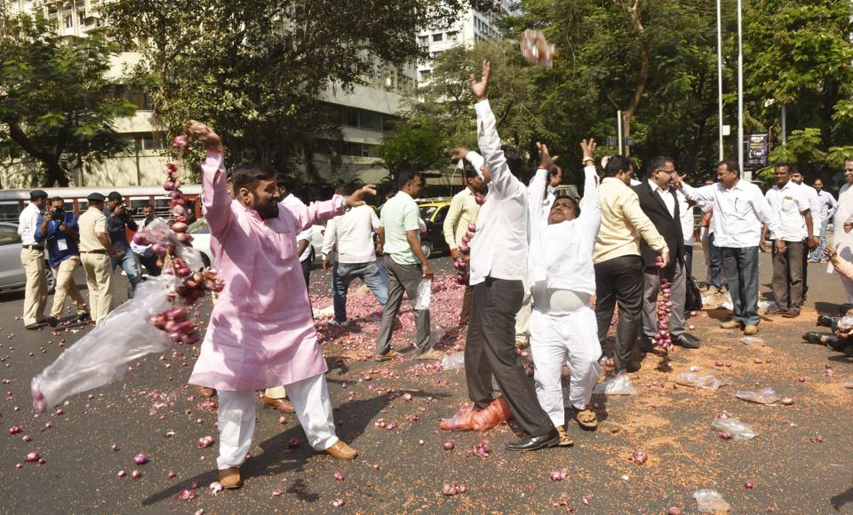 Members of Swabhimani Shetkari Paksha, a farmers' outfit, throw onions at the cars of minister outside the Vidhan Bhavan on Tuesday.
