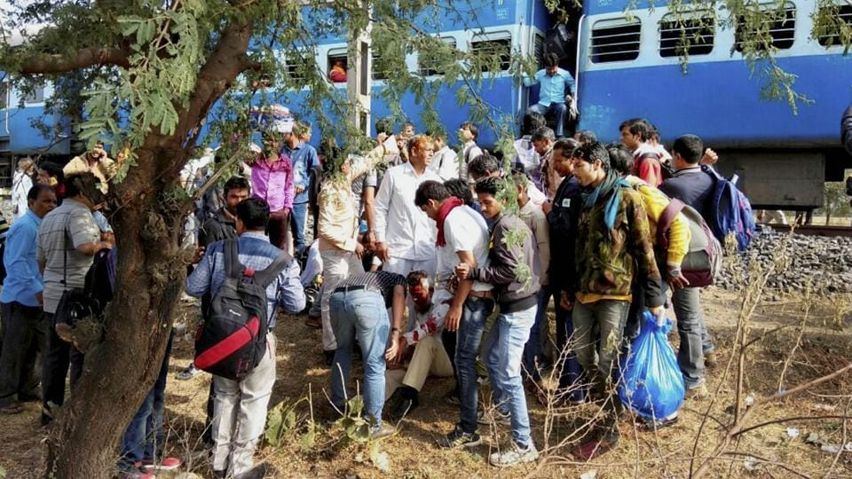 People attend to an injured person after a blast in the Bhopal-Ujjain passenger train near Jabdi station in Shajapur district in Madhya Pradesh on Tuesday.
