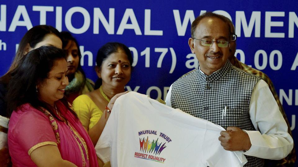 Sports Minister Vijay Goel (right)unveils a jersey during a conference on 'Women and Sports in India' on the occasion of International Women's Day, in New Delhi on Wednesday.