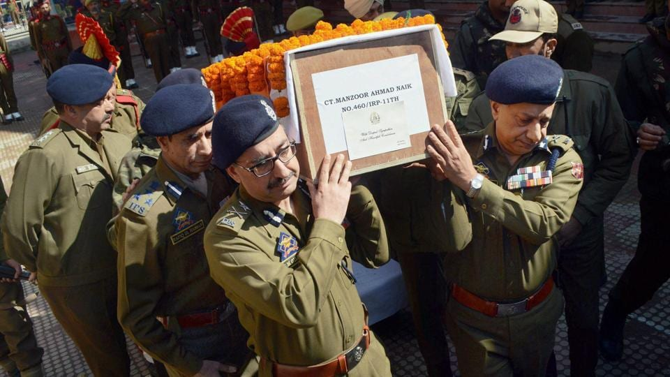 Kashmir DGP SP Vaid (right) and IGP SJM Gillani along with senior officers carry the body of constable Manzoor Ahmad who was killed during an encounter in Tral on March 5.