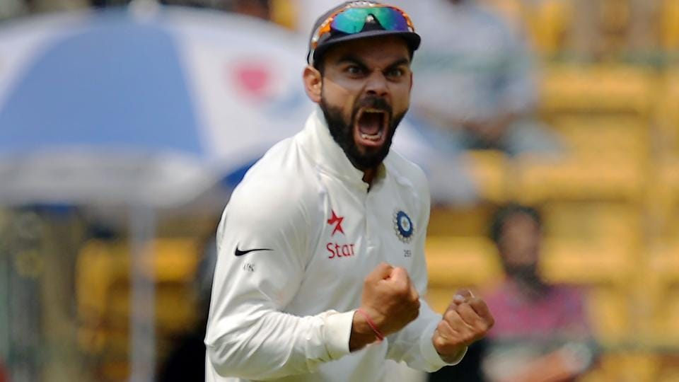 Virat Kohli celebrates after India's victory over Australia in the second Test match in Bangalore.