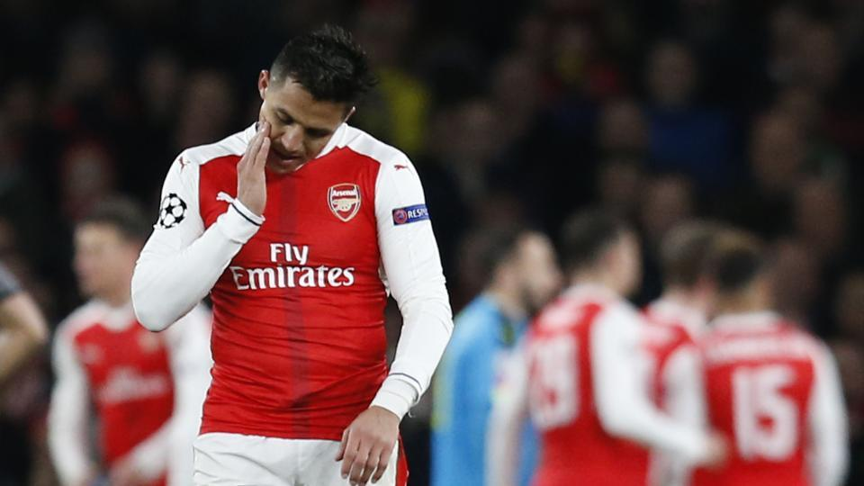 Arsenal's Alexis Sanchez (C) reacts after Bayern Munich scored their second goal during the UEFA Champions League match against Bayern Munich.
