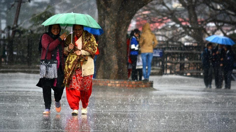 Women walk during rain at Ridge area in Shimla, Himachal Pradesh in February.