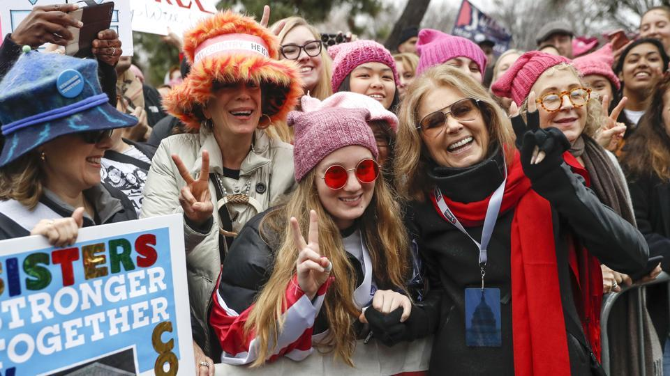 On January 21,  Gloria Steinem, centre right, greets protesters at the barricades before speaking at the Women's March during the first full day of Donald Trump's presidency in Washington.