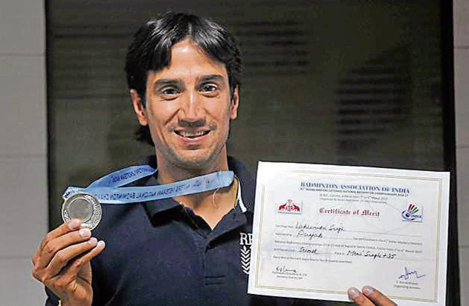 Badminton player Lakhwinder Singh showing his medal and certificate in Ludhiana on Wednesday.