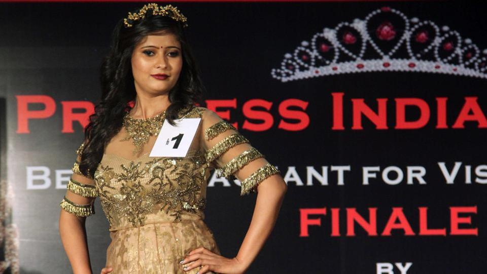 A beauty pageant declared its winners on Wednesday, with the finalists walking a ramp, taking questions and performing in a talent show round. What made it unique was that all 16 contestants were either fully or partially blind. (Pramod Thakur/HT PHOTO)