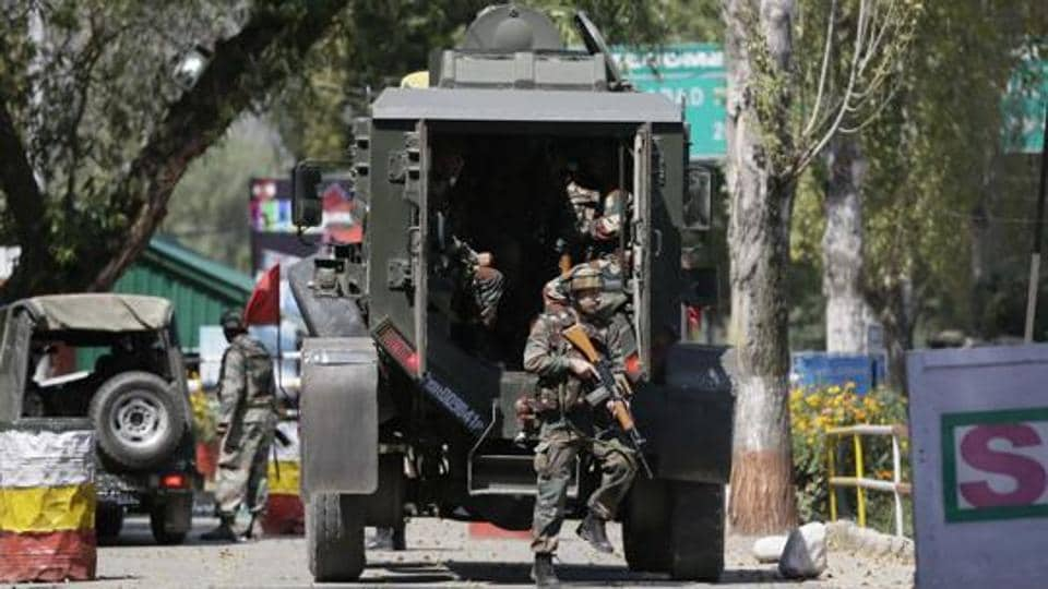 Soldiers arrive at the army base which was attacked by suspected Pakistani militants in Uri.