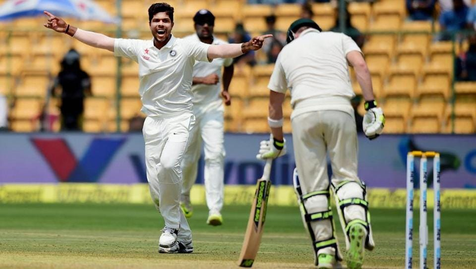 Umesh Yadav celebrates the wicket of Steve Smith on day 4 of the second India vs Australia Test in Bangalore on Tuesday.