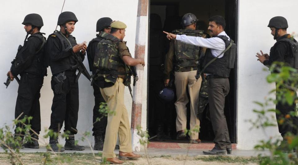 Uttar Pradesh ATS at Hazi colony near Kakori in Lucknow. After a nine-hour sporadic gunfight, police said the two suspects were wounded but still holed up in the house.