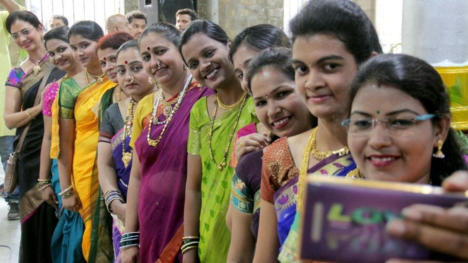 Women pose for a photo  during an event organised  by the Central Railway. (Bhushan Koyande/ht photo)