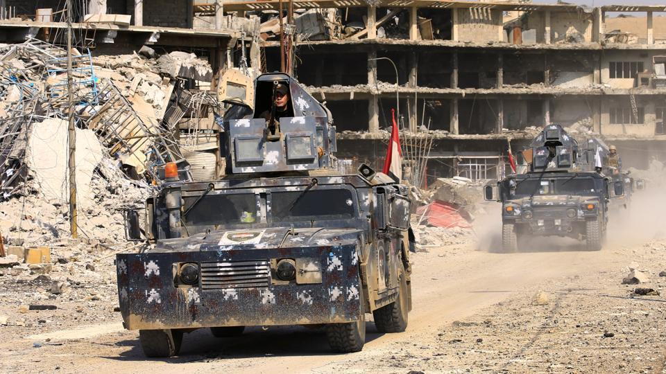 Military vehicles of federal police are seen during a battle with Islamic State militants at Dawasa neighborhood in Mosul, Iraq, March 8, 2017. REUTERS/Thaier Al-Sudani