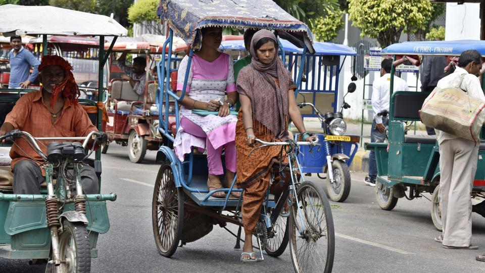 'Pulling along' in a man's world: Ranju Devi, mother of three,  holds her own in a profession almost completely dominated by men. Ranju became a cycle rickshaw puller in order to supplement her family income. (Sanjeev Verma/HT Photo)