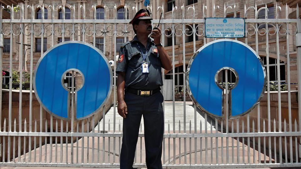 A security personnel stands guard in front of the gate of the State Bank of India (SBI) regional office in Kolkata. The bank is facing a backlash for levying penalty on non-maintenance of minimum balance in accounts.