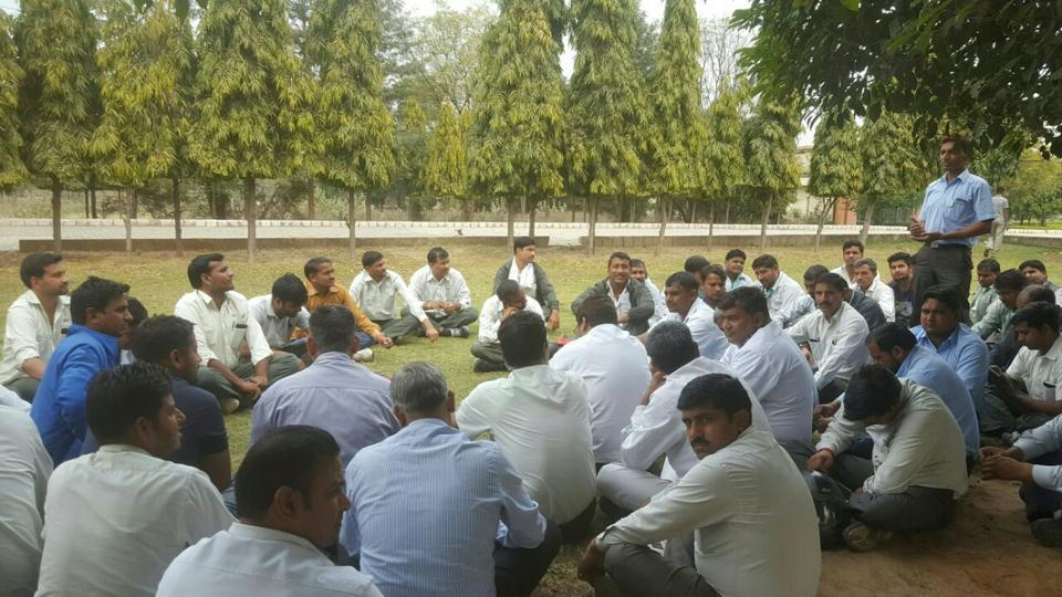 Representatives of various workers' unions met at a Manesar park on Tuesday. They warned of a strike if the court decision was against workers.