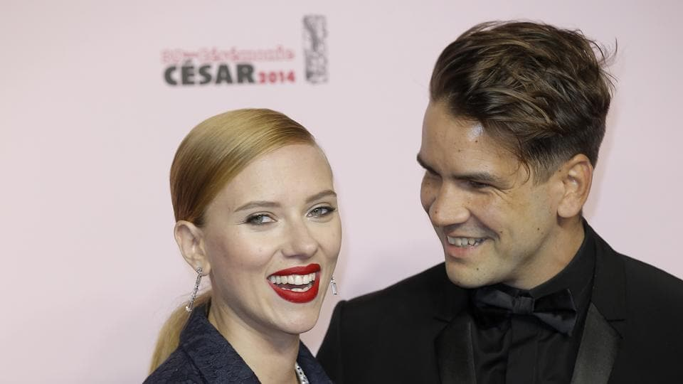 Scarlett Johansson and her partner Romain Dauriac arrive at the 39th French Cesar Awards Ceremony, in Paris.