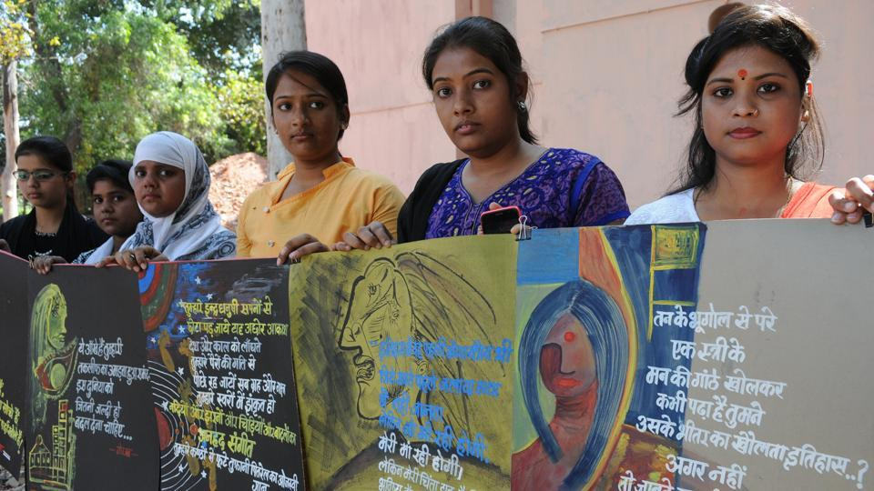 Students display placards at an exhibition on International Women's Day, in Patna .