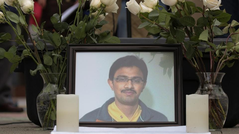 A picture of Srinivas Kuchibhotla, an immigrant from India who was recently shot and killed in Kansas, is surrounded by roses during a vigil in honor of him at Crossroads Park in Bellevue, Washington, U.S. March 5, 2017.