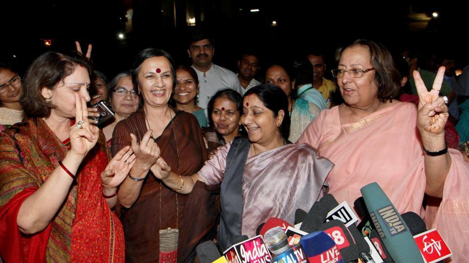 Political leaders Sushma Swaraj, Najma Heptullah, CPI (M) leader Brinda Karat show a victory sign as they celebrate passing of the Women's Reservation Bill in Rajya Sabha, New Delhi.