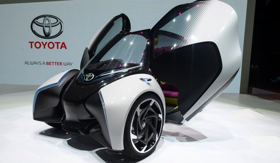 a toyota i tril electric concept car is displayed at the japanese carmaker stand during