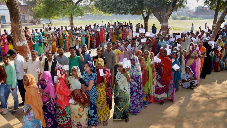 People line up at a polling station in Mirzapur during the seventh and final phase of voting in Uttar Pradesh on Wednesday.