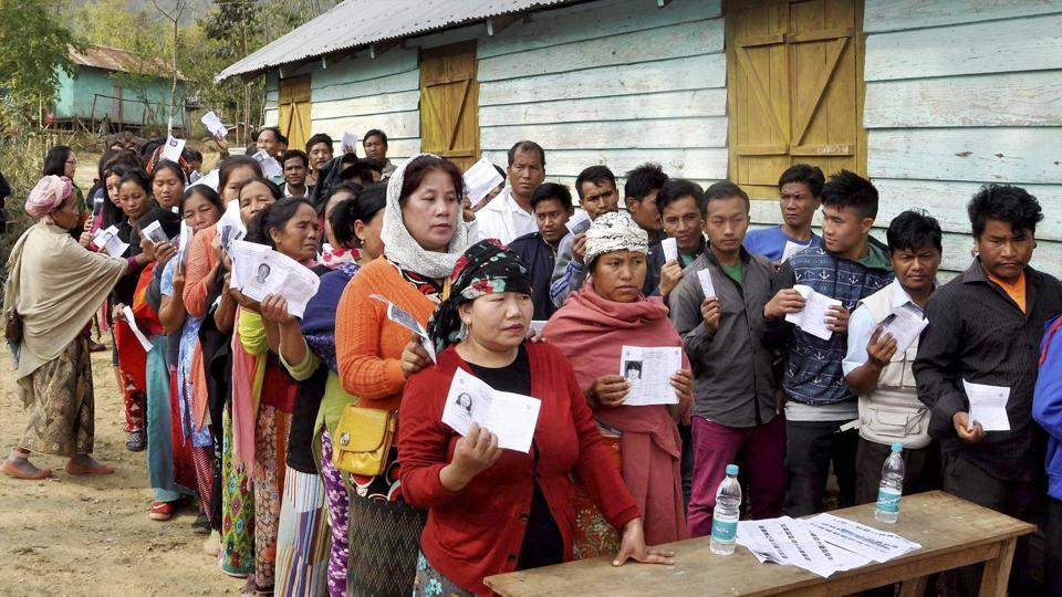 Manipuri people stand in queues to cast their votes in Chandel constituency of Manipur on Wednesday during the last phase of state assembly elections.