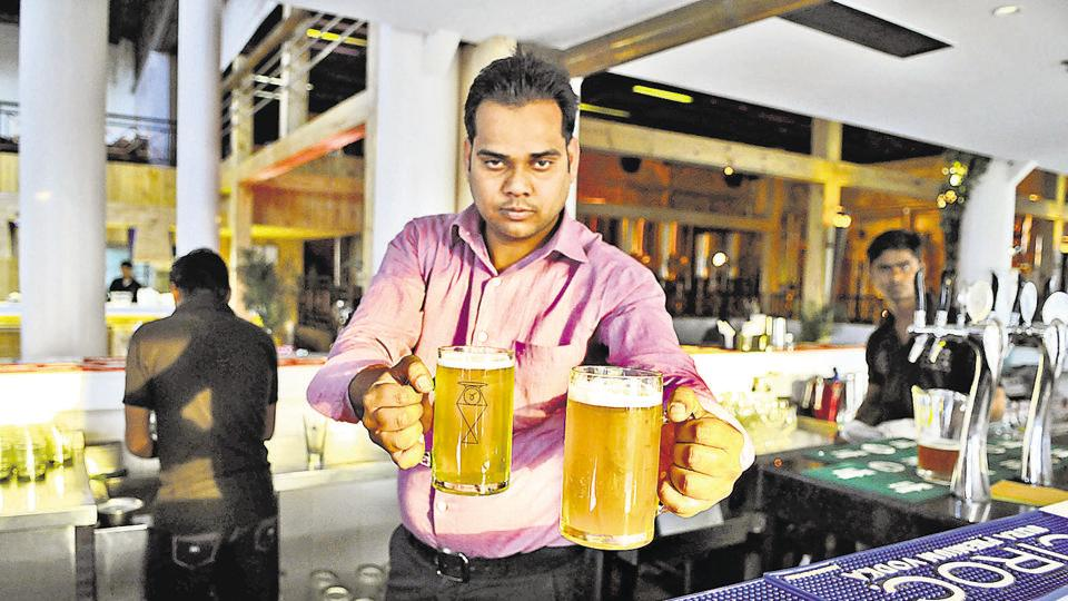 A bartender serves beer at a brewery in Star Mall. Brewery owners say the move will encourage fresh beer drinkers to turn to hard liquor, hitting the retail beer trade.