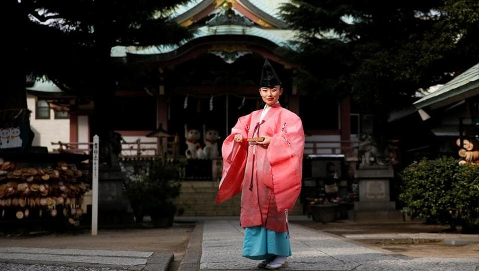 Shinto priest Tomoe Ichino, 40, poses for a photograph at the Imado Shrine in Tokyo, Japan, February 22, 2017. 'In general, people think being a Shinto priest is a man's profession. If you're a woman, they think you're a shrine maiden, or a supplementary priestess. People don't know women Shinto priests exist, so they think we can't perform rituals. Once, after I finished performing jiichinsai (ground-breaking ceremony), I was asked, 'So, when is the priest coming?','Ichino said. 'When I first began working as a Shinto priest, because I was young and female, some people felt the blessing was different. They thought: 'I would have preferred your grandfather.' At first, I wore my grandfather's light green garment because I thought it's better to look like a man. But after a while I decided to be proud of the fact that I am a female priest and I began wearing a pink robe, like today. I thought I can be more confident if I stop thinking too much (about my gender).' (Toru Hanai  / REUTERS)